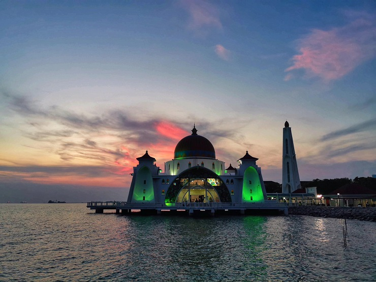 mosque on water at sunset