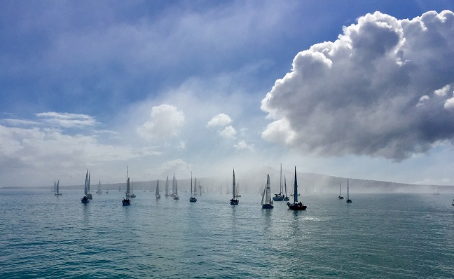 sailing boats in mist