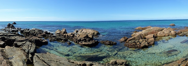 sea horizon with clear water and rocks