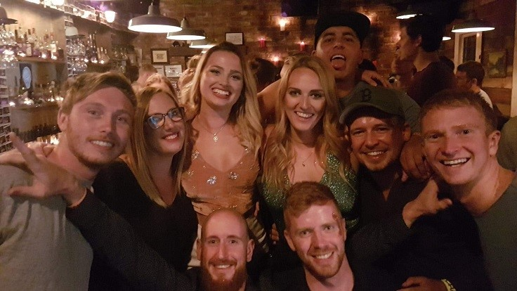group of people in bar smiling