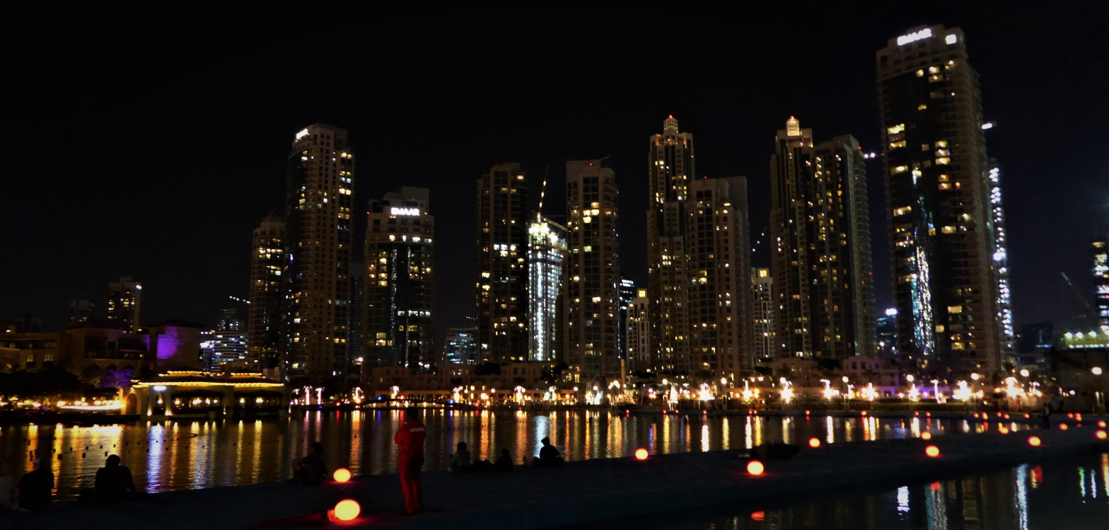 buildings lit up at night in Dubai