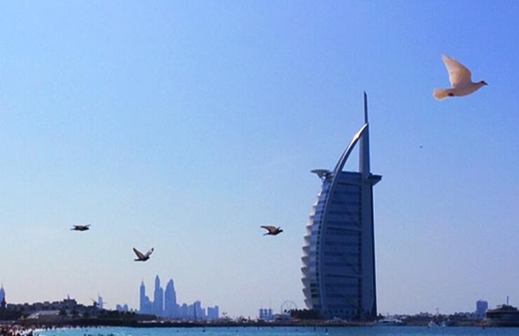 Burj al Arab with bird flying across the sky